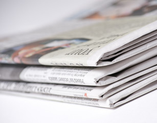 Newspapers on light background shot