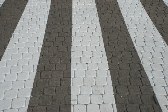 White walkway grids on the gray cobbles