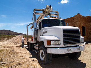 White truck at a construction site. Horizontal