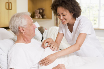Nurse Helping Senior Man