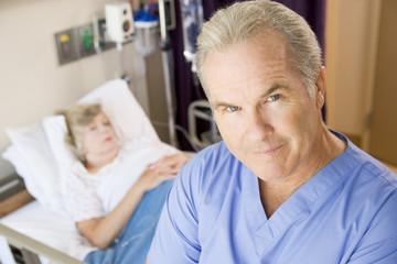 Doctor Standing In Patients Room,Looking Serious