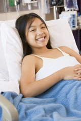 Young Girl Smiling,Lying In Hospital Bed