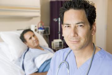 Doctor Standing In Patients Room