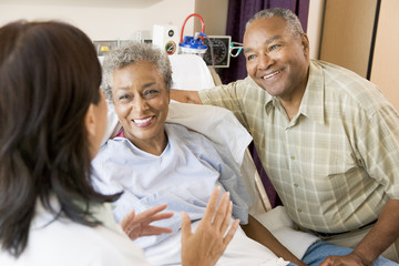 Nurse Talking To Senior Couple