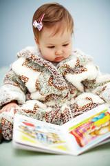 Small cute  reading a book