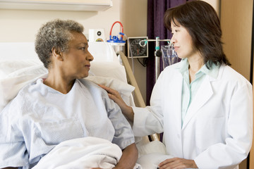 Doctor And Patient Looking At Each Other