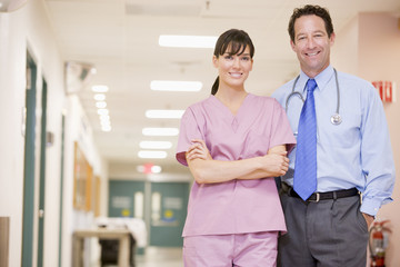 Doctor And Nurse Standing In A Hospital Corridor