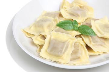Simple ravioli pasta dish on white background