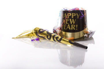 Party favors including top hat that says Happy New Year