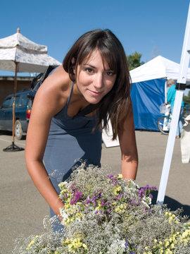 Beautiful young Hispanic woman shopping for flowers