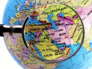 Photo sur Aluminium Moyen-Orient Close up of middle east map seen through magnifying glass