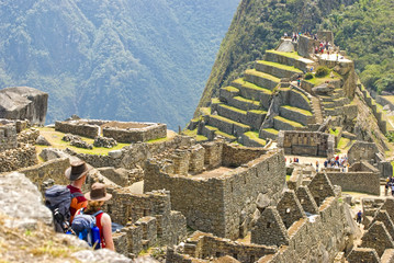 Couple admiring Inca sanctuary of Machupicchu. Cusco, Peru