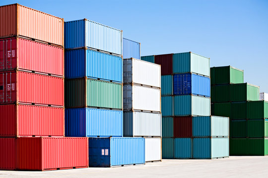cargo shipping containers stacked at harbor freight terminal