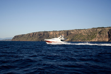 The motorboat drives fast on the sea.