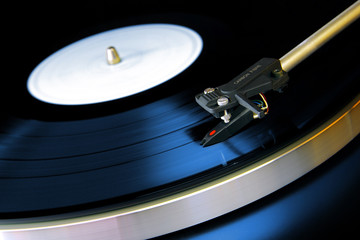 Close up on a vinyl record playing on a turntable