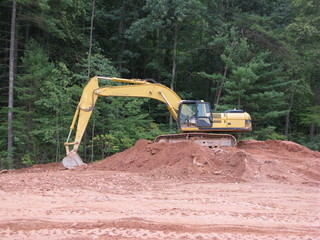 earthmoving equipment in various stages of project