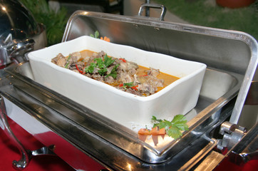 chicken curry soup in chafing dish at buffet dinner