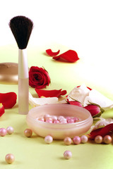 Red and white rose petals and heads with pouder