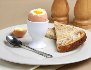 Soft boiled egg with buttered toast