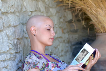 Cancer survivor while reading her book in positive attitude