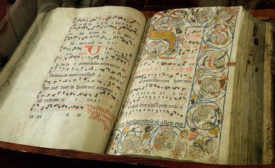 medieval religious book with dots and illumination