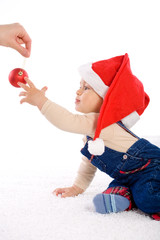 One year old baby boy in santa's hat, smiling.