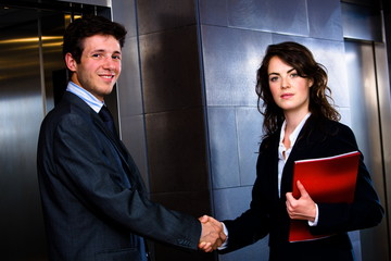 Happy young businesspeople