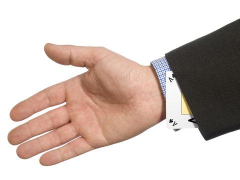 A man's hand hiding an ace up his sleeve.