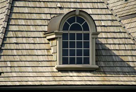 Window on a wood shingle roof