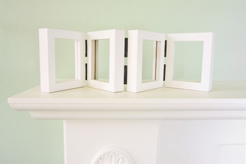 mantel with empty picture frame for your pictures