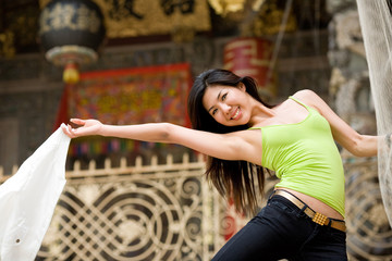 happy asian young woman at the heritage site