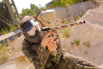 Paintball player in camouflage, outdoors