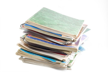 column of old copybooks isolated over white