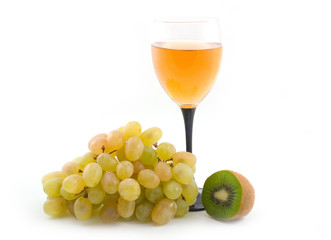 light wine and grapes with a green fruit on white background