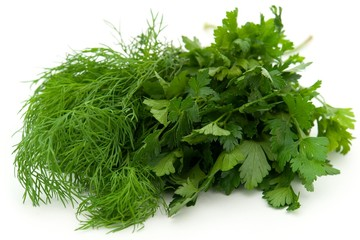 Fresh green dill and parsley on a white background