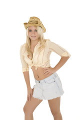 Beautiful and sexy Caucasian cowgirl on white background