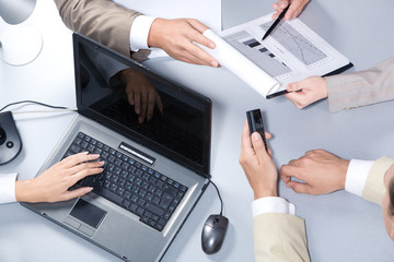 Close-up of business people hands working