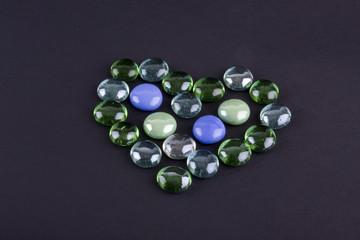 Glass stones making heart shape