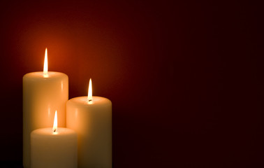 Three candles on a red background
