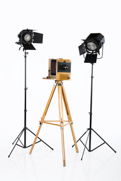 Old wooden photocamera and lighting