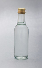 Bottle of transparent liquid isolated