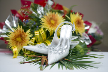 Wedding shoes and flowers