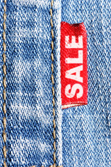Blue jeans and red label  with word SALE