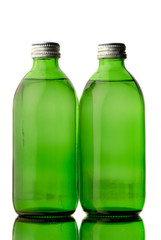 two bottles  green color with mineral water