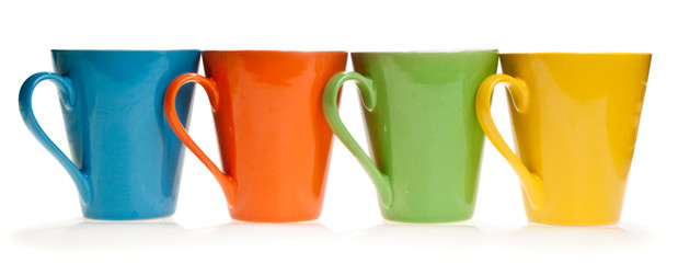 Multicolored cups in a row, isolated, on white background