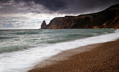 Pebbles beach and mountain near the sea