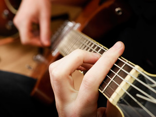 Musician playing  electric guitar, shallow depth of field