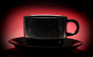 black cup over red background