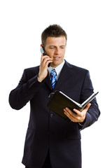 Happy businessman  calling on cellphone, smiling,
