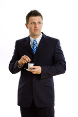 businessman drinking coffee, smiling, isolated on white.